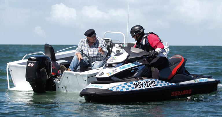 Photo of a boat operator being pulled over by a maritime safety officer