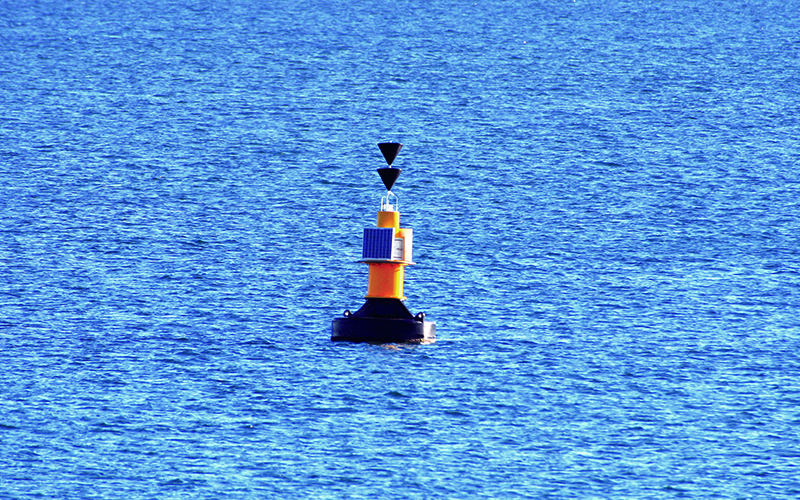 A yellow buoy in the water