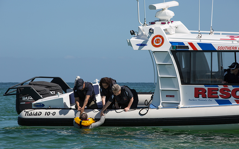 Rescuers pull a man from the water