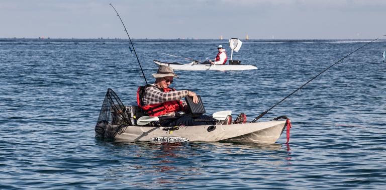 Photo of a man kayak fishing