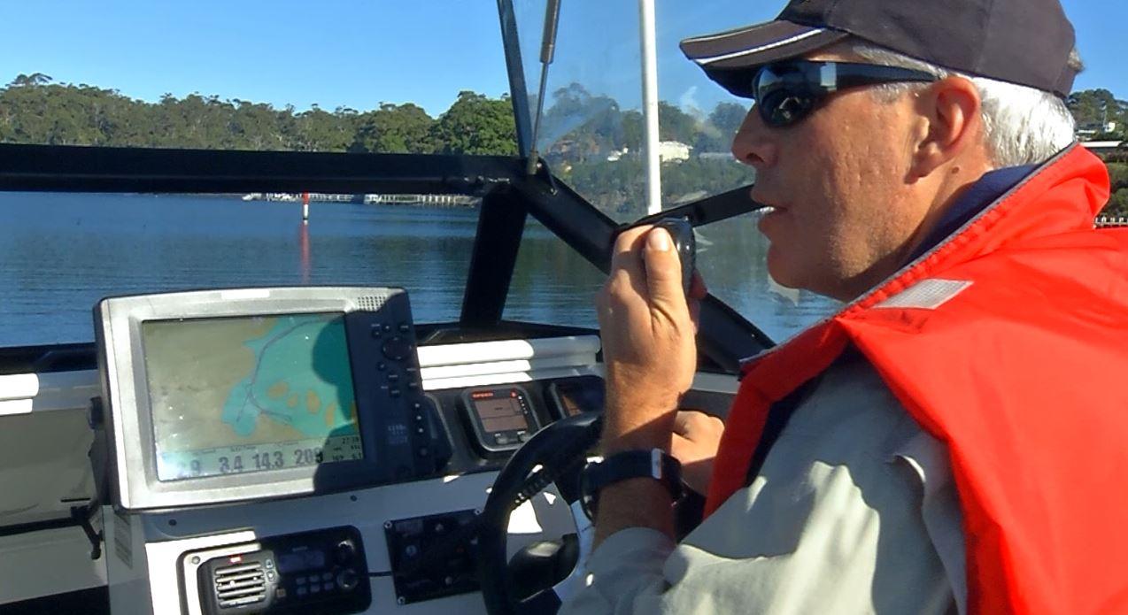 Man using marine radio
